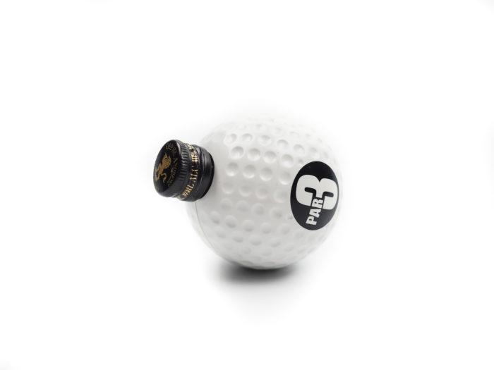 Reklamní předmět - panák v podobě golfového míčku